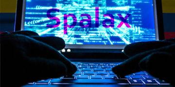 """Hacker en computadora con palabra """"Spalax"""" en pantalla con bandera de Colombia en el fondo, Composición por CriptoNoticias. twenty20photos / elements.envato.com; twenty20photos / elements.envato.com."""